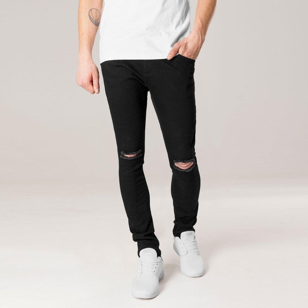 svarta jeans med hål på knäna herr